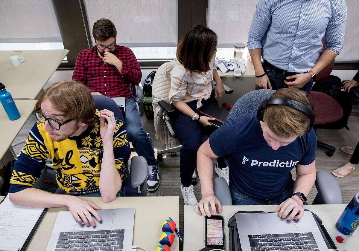 (From left) Predictim employees Stephen Ramaley, Will Bricker, Iris Ye and Joel Simonoff work at their desk at SkyDeck in Berkeley, Calif. Thursday, Nov. 15, 2018.