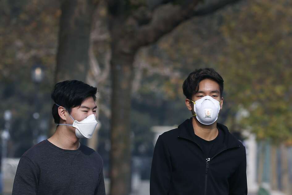 York Wang (left) and Chris Ko wear breathing masks while walking theough Sproul Plaza at UC Berkeley on Friday, Nov. 16, 2018. Ko says he?•s already sick, so trying to avoid the bad air is really difficult. University officials cancelled classes Friday because of the unhealthy air conditions which continue to choke the Bay Area with heavy smoke from the Camp Fire in Butte County.
