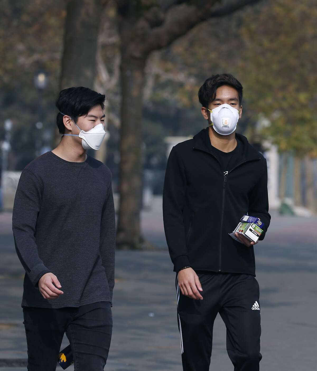 HOW BAD IS THE AIR? Keep clicking or swiping through the gallery to see BEFORE and AFTER. ==> York Wang (left) and Chris Ko wear breathing masks while walking theough Sproul Plaza at UC Berkeley on Friday, Nov. 16, 2018. Ko says he?•s already sick, so trying to avoid the bad air is really difficult. University officials cancelled classes Friday because of the unhealthy air conditions which continue to choke the Bay Area with heavy smoke from the Camp Fire in Butte County.
