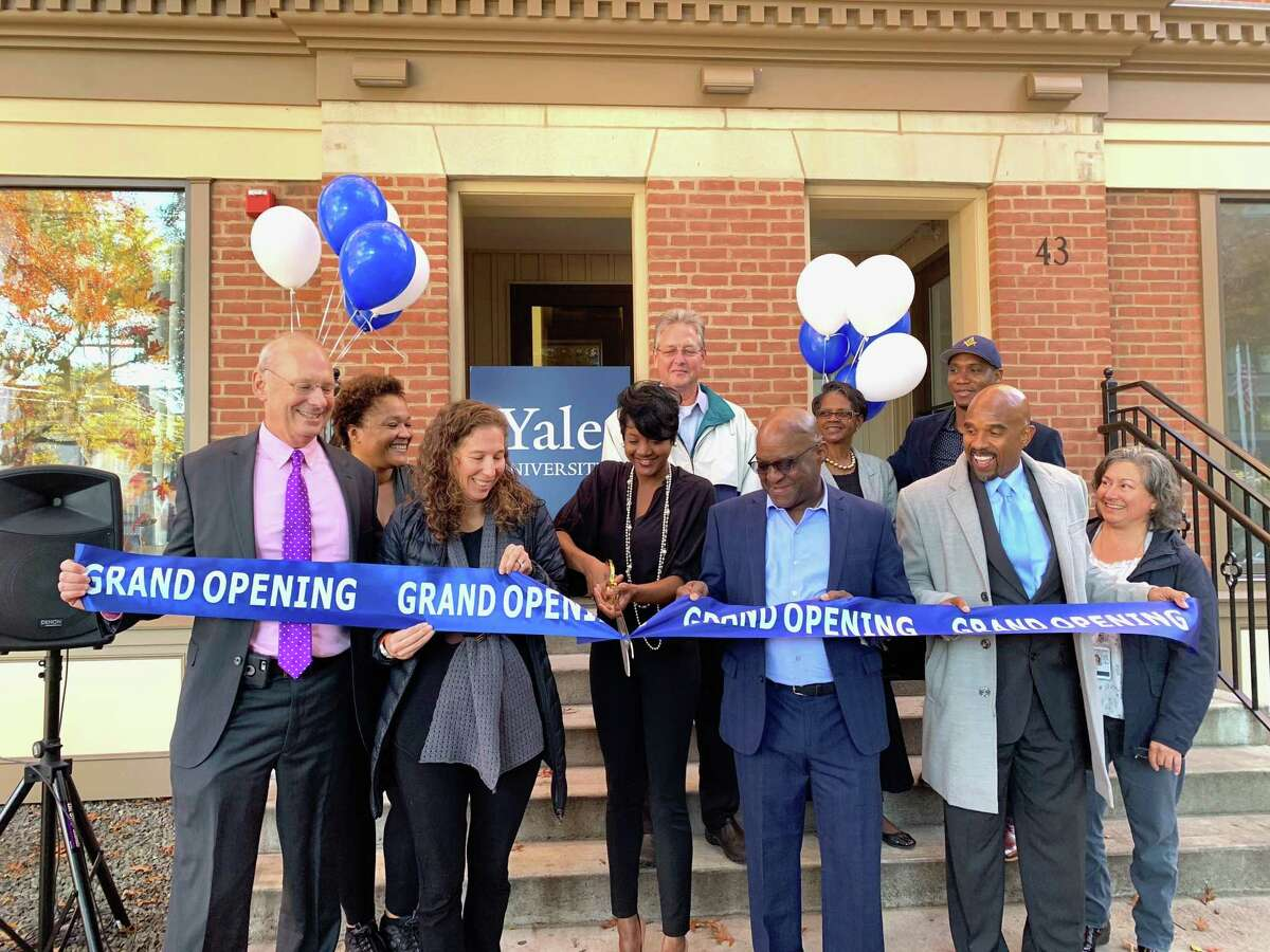 NEW SALON OPENS: Ebony Selima Peterson-Dease, center, owner of Salon E'Selim, cuts the ribbon at a ceremony recently for the new salon, 45 Whalley Ave. in New Haven. The salon offers haircuts, extensions, coloring, bridal services, natural hair care and more. Business hours are from 9:30 a.m. to 2 p.m. Tuesday; 9:30 a.m. to 6 p.m. Wednesday through Friday; and from 8:30 a.m. to 2 p.m. Saturday.