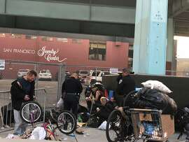 San Francisco Police Chief Bill Scott and Lt. Tad Yamaguchi make an impromptu stop at a budding homeless encampment at Showcase Square.