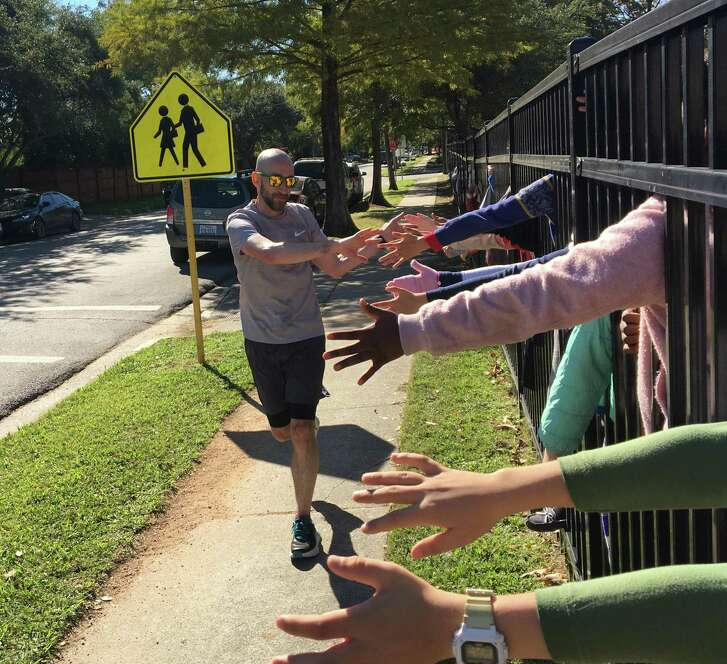 Students at Condit Elementary School cheer on Principal Dan Greenberg as he completes the last of 50 laps around his Bellaire campus -- a 20.23-mile run -- as a reward for students raising funds from all 50 states for new campus technology.