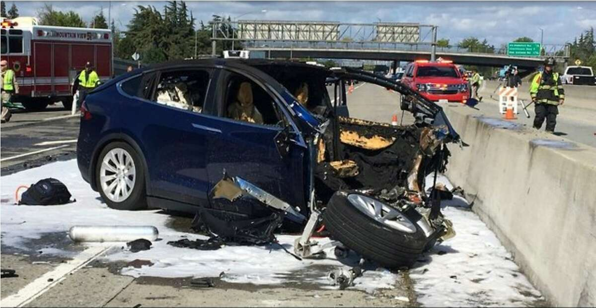 """In this March 23, 2018, file photo provided by KTVU, emergency personnel work a the scene where a Tesla electric SUV crashed into a barrier on U.S. Highway 101 in Mountain View, Calif. The test results by AAA released Thursday, Nov. 15, 2018, come after several highly publicized crashes involving Tesla vehicles that were operating on the company's system named """"Autopilot."""" The National Transportation Safety Board is investigating some of the crashes, including the March fatality that involved a Model X that struck a freeway barrier. (KTVU via AP, File)"""