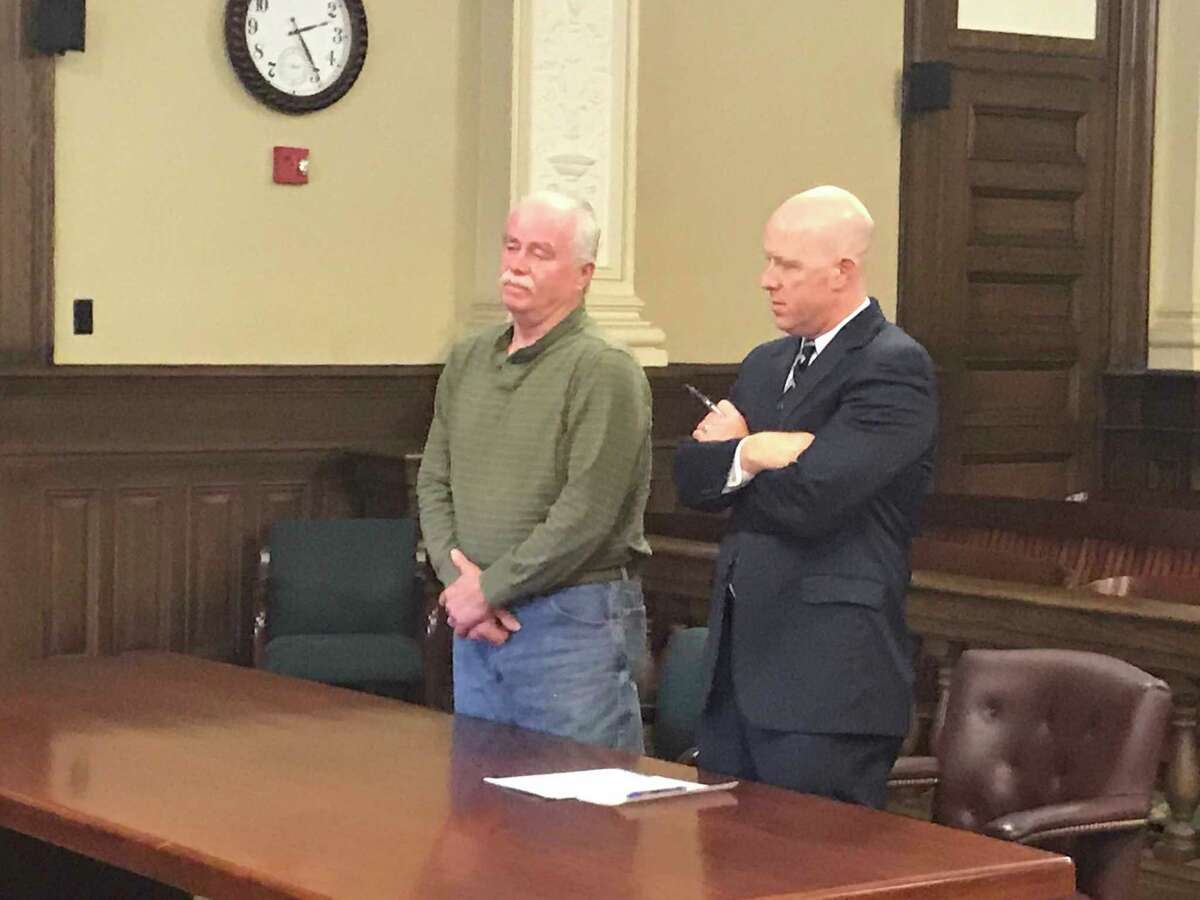 Defendant William A Cavanaugh Sr. pleaded guilty while standing by his attorney Lee Kindlon in Rensselaer County Court in Troy, N.Y. Friday Nov. 16, 2018.