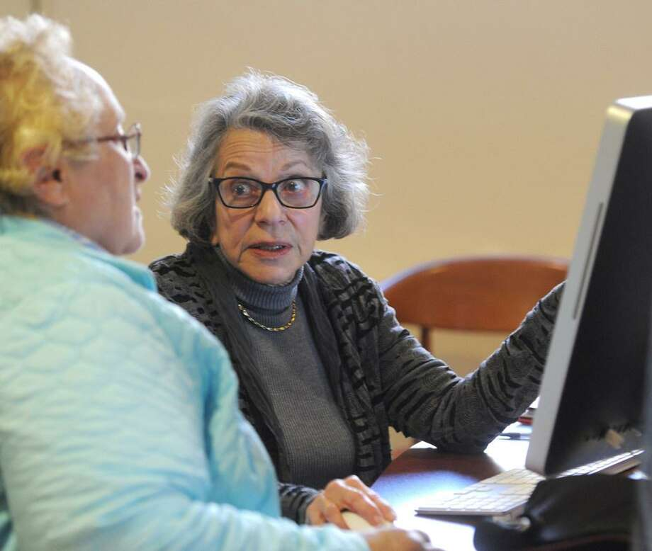 Greenwich resident Donna Santoro, left, gets help from Medicare counselor Naomi Myers at the Medicare Part D counseling session at the Senior Center in Greenwich, Conn. last year. Such seniors, including many in Texas, stand to gain if some Trump proposals on the program happen. Photo: /