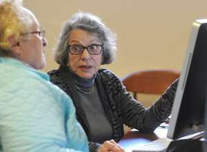 Greenwich resident Donna Santoro, left, gets help from Medicare counselor Naomi Myers at the Medicare Part D counseling session at the Senior Center in Greenwich, Conn. last year. Such seniors, including many in Texas, stand to gain if some Trump proposals on the program happen.