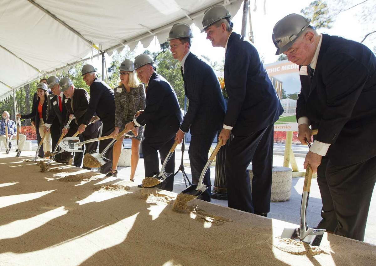 Sam Houston State University held a groundbreaking ceremony for its College of Osteopathic Medicine building, Friday, Nov. 16, 2018, in Conroe. The project consists of a five-story 216,000 square foot building on 7.3 acres on Interstate 45 just south of South Loop 336. Sam Houston State choose osteopathic medicine, a branch of the profession that takes a more holistic approach than traditional medicine, in large part because graduates are more likely to practice primary care medicine and center their practice in rural areas and places like East Texas, where a long-standing shortage of doctors is worsening and some patients must travel 100 miles or more to find care.