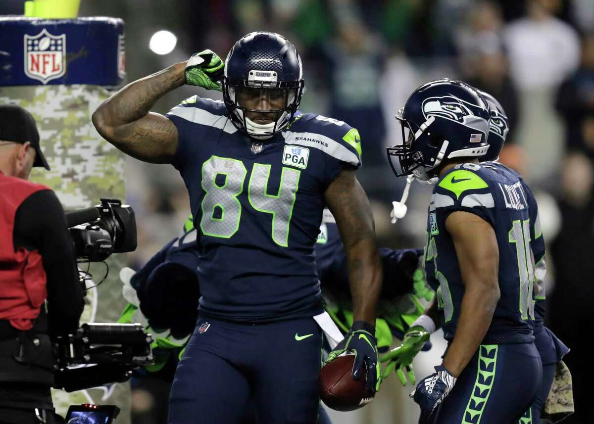 Seattle Seahawks tight end Ed Dickson (84) celebrates after scoring a touchdown against the Green Bay Packers during the second half of an NFL football game Thursday, Nov. 15, 2018, in Seattle.