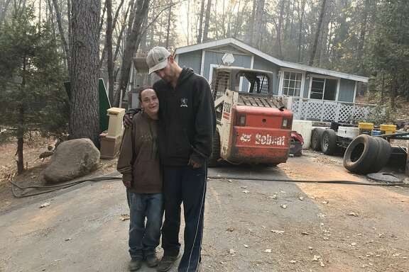 Tosha Sumrall, 36, and her husband, Matthew Schlegel, 40, stayed behind in their RV park in Magalia during the fires because they didn't have a car and couldn't get out. Instead, they used hoses and pumped water from the hand-washing stations near the portable toilets to douse the flames that threatened their and their neighbor's homes.