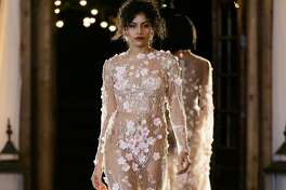 This sheer floral look was a softer, more feminine moment in the designer's spring couture line.