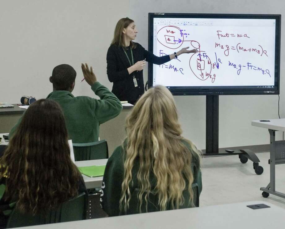 Trinity Catholic teacher Penka Petkova working with students in the newly renovated Physics room at the school. Thursday, Nov. 15, 2018 Photo: Scott Mullin / For Hearst Connecticut Media / The News-Times Freelance