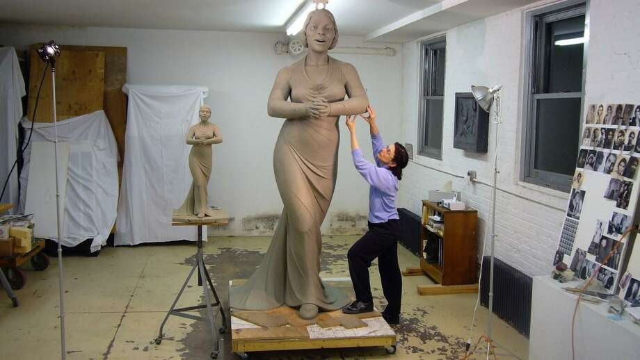 Meredith Bergmann, of Ridgefield, works on a statue of Marian Anderson she was commissioned to sculpt for Converse College. She is currently working on statues of suffragettes for Central Park in New York. Photo: Contributed Photo / The News-Times Contributed
