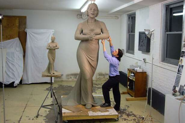 Meredith Bergmann, of Ridgefield, works on a statue of Marian Anderson she was commissioned to sculpt for Converse College. She is currently working on statues of suffragettes for Central Park in New York.