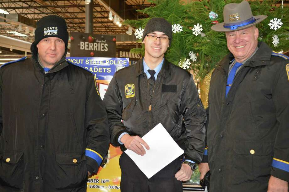 State troopers and state police cadets accepted donations over a 12-hour period Friday at the Stop & Shop in Litchfield. From left, Kent Resident Trooper Andrew Fisher, cadet Matt Divergilio and Litchfield Resident Trooper Jim Holm. Photo: Leslie Hutchison / Hearst Connecticut Media