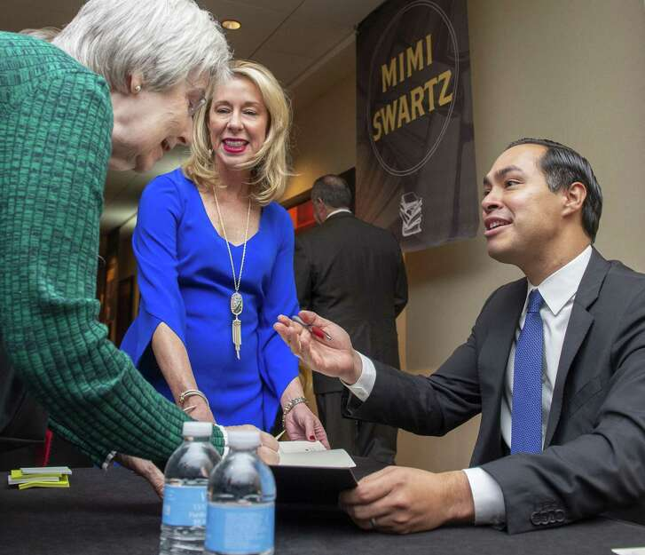 "Former United States Secretary of Housing and Urban Development, San Antonio Mayor and author Julian Castro autographs books during the luncheon. He recently published his memoir ""An Unlikely Journey: Waking Up From My American Dream."""