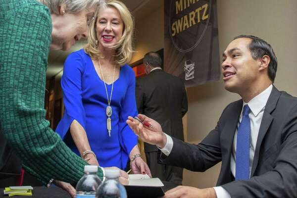 """Former United States Secretary of Housing and Urban Development, San Antonio Mayor and author Julian Castro autographs books during the luncheon. He recently published his memoir """"An Unlikely Journey: Waking Up From My American Dream."""""""