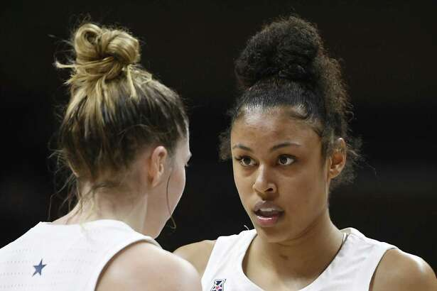 UConn's Katie Lou Samuelson, left, talks with Olivia Nelson-Ododa during an exhibition game on Nov. 4 in Storrs.
