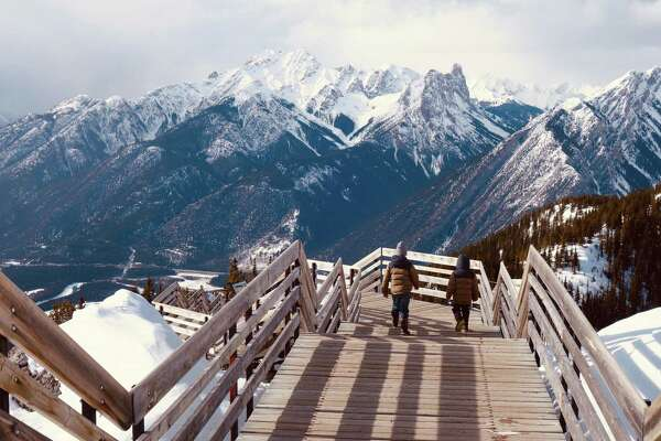 Henry and Silas Walker stroll along the Sulphur Mountain Boardwalk, which takes visitors on a ridgeline walk and delivers 360-degree views of the Bow River Valley.