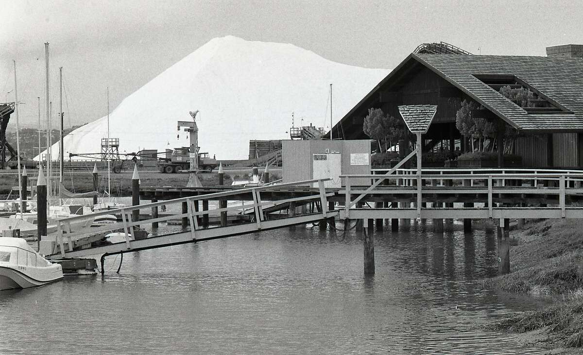 The Leslie Salt Company harvested salt from the salt ponds in Redwood City and for years the giant salt mountain, sat near the Redwood City Marina and Highway 101, March 29, 1977