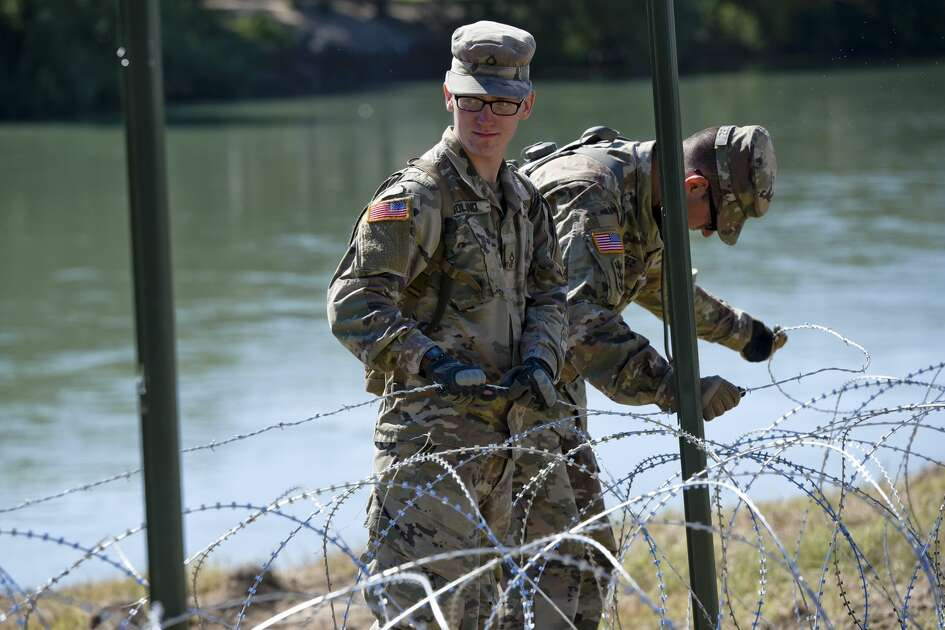 The U.S. military installs barbed concertina wire along the banks of the Rio Grande on Friday, Nov. 16, 2018 as they reinforce the border and ports of entry in Laredo, Texas.