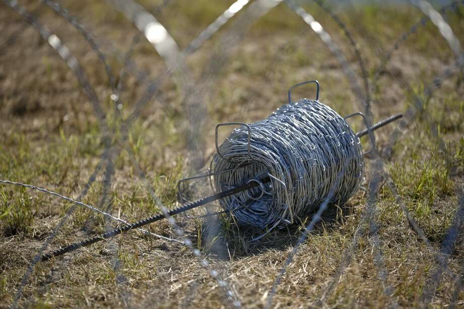 A view of barbed concertina wire used along the banks of the Rio Grande on Friday, Nov. 16, 2018, is shown as the U.S. military reinforces the border and ports of entry in Laredo, Texas. Photo: Danny Zaragoza/Laredo Morning Times