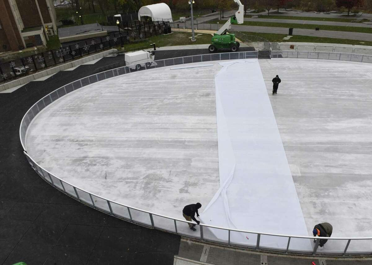 Crews put the finishing touches on the new ice rink at Mill River Park in Stamford, Conn. Thursday, Nov. 15, 2018. The rink will officially open next weekend.