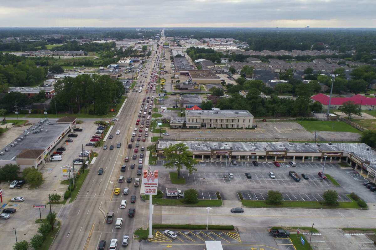 """Traffic stacks up on FM 1960 between Ella Blvd. and Kuykendahl Road on Sept. 27. Though the road is heavily urbanized, it will remain a farm-to-market road after state transportation officials axed a 23-year-old designation calling it an """"urban road."""""""