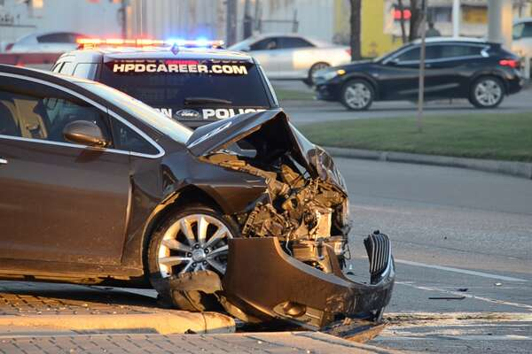 Houston police cruiser flips in crash along East Freeway