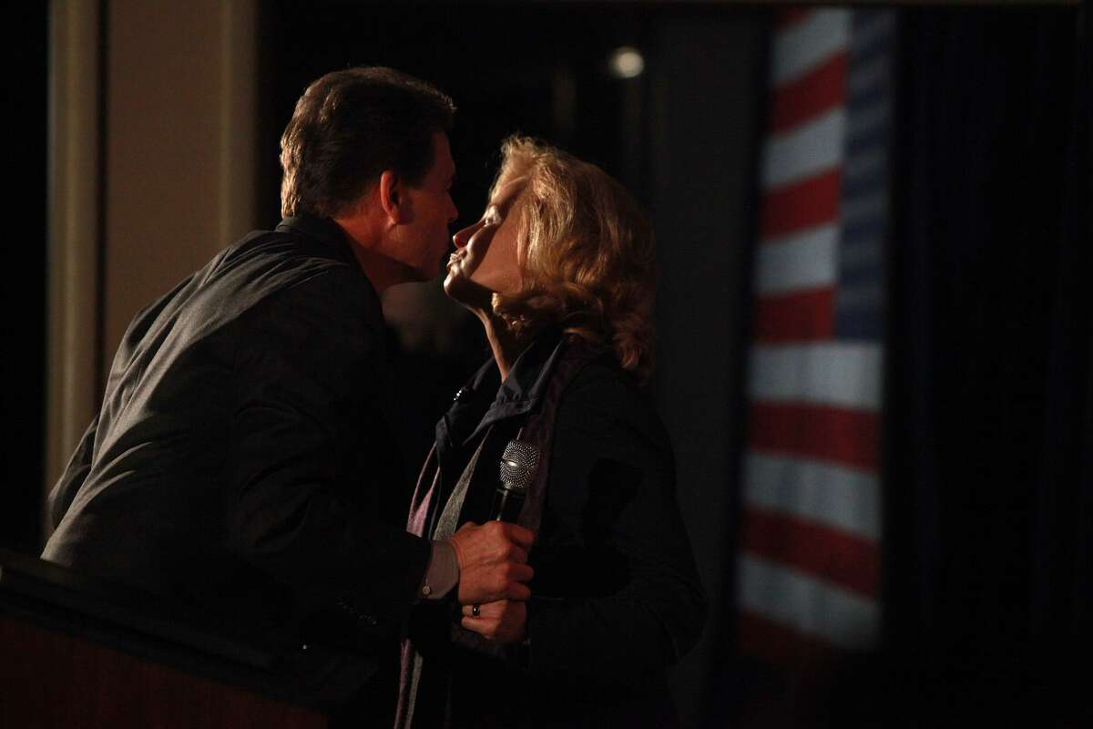 Republican presidential candidate Governor Rick Perry leans to kiss his wife, Anita Perry, after she introduced him during the Cerro Gordo County GOP Fundraiser at the Mason City Country Club in Mason City, IA on Friday, Dec. 30, 2011.