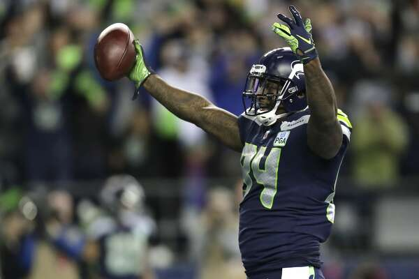 Seattle Seahawks tight end Ed Dickson celebrates after he scored a touchdown against the Green Bay Packers during the second half of an NFL football game, Thursday, Nov. 15, 2018, in Seattle. (AP Photo/Stephen Brashear)