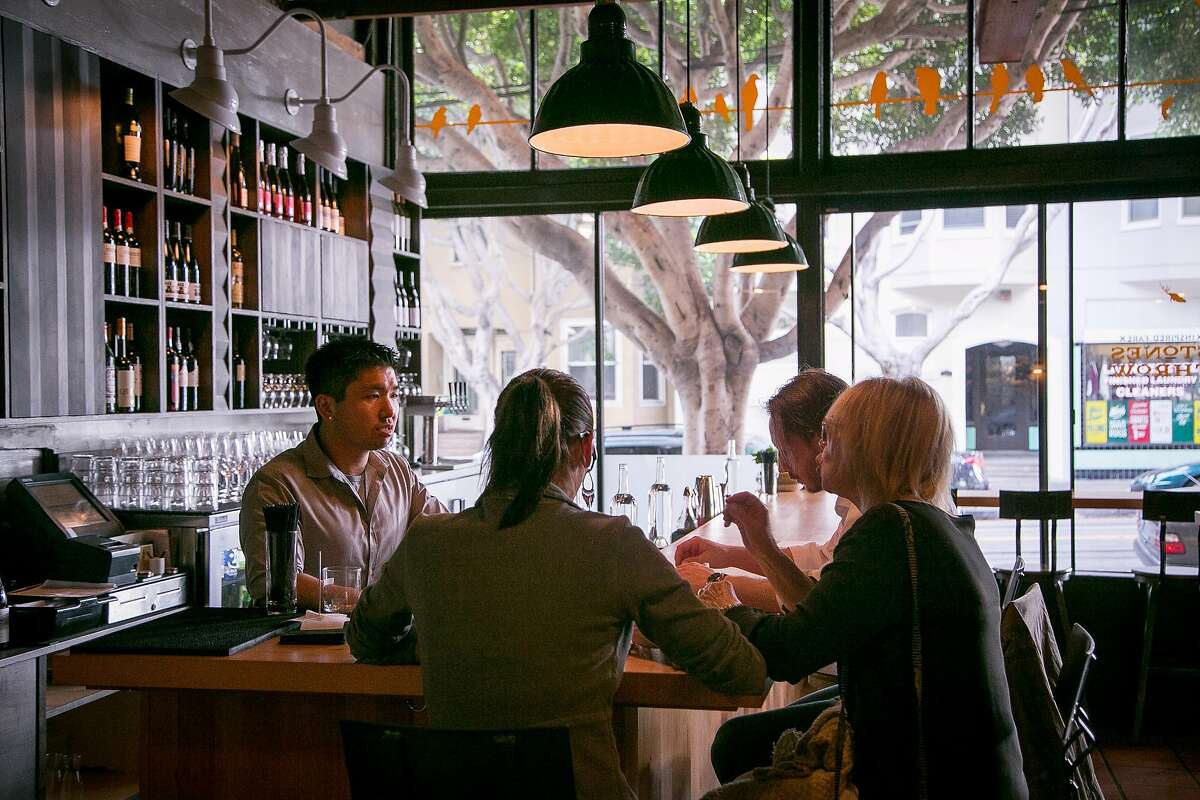 Bartender James Uryu talks with customers at Stones Throw in San Francisco, Calif. on August 6th, 2014.