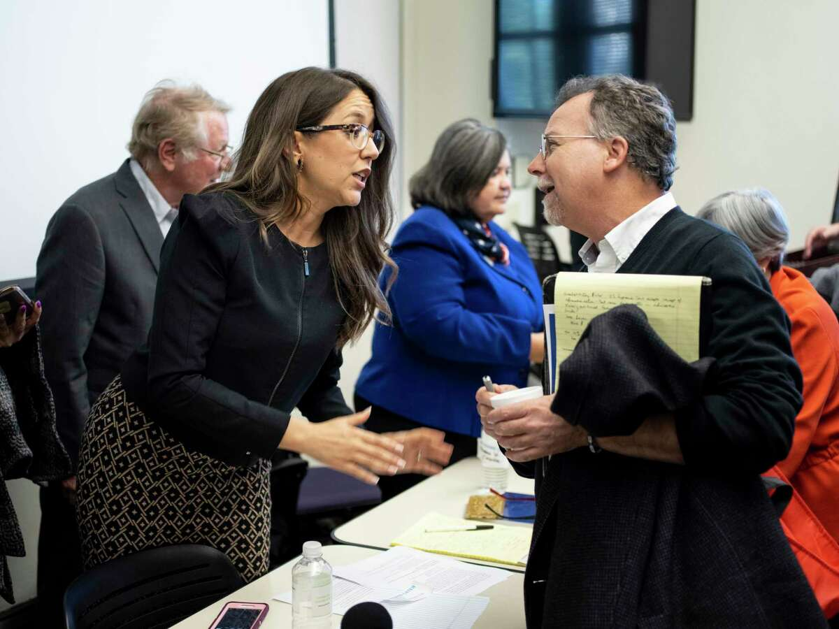 Celina Moreno, JD, with the Mexican American Legal Defense and Educational Fund, left, speaks with attendee Patrick Smith, right, after a panel discussion at Our Lady of the Lake University during a conference celebrating 50 years since the 1968 U.S. Commission on Civil Rights hearing at the school, on Friday, November 16, 2018.