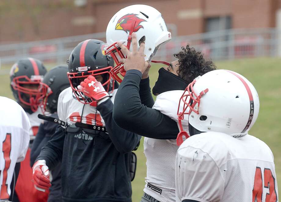 Lamar players bundle up and brace against a freezing wind as they get in a cold day of practice and prepare for Saturday's game against rival McNeese.  Photo taken Tuesday, November 13, 2018  Kim Brent/The Enterprise Photo: Kim Brent / The Enterprise / BEN
