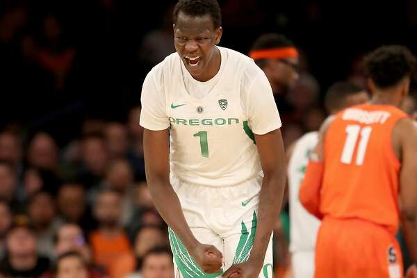 NEW YORK, NEW YORK - NOVEMBER 16: Bol Bol #1 of the Oregon Ducks celebrates his three point shot in the second half against the Syracuse Orange during the 2K Empire Classic at Madison Square Garden on November 16, 2018 in New York City.The Oregon Ducks defeated the Syracuse Orange 80-65. (Photo by Elsa/Getty Images)