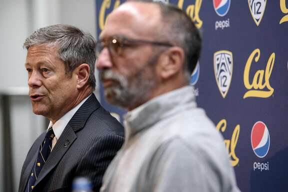 """Director of Athletics Jim Knowlton, left, and Assistant Vice Chancellor Executive Communications Dan Mogulof answer questions during a press conference announcing that the """"Big Game"""" versus Stanford University is canceled due to poor air quality, held on the Cal campus in Berkeley, California, on Friday, November 16, 2018."""