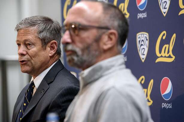 "Director of Athletics Jim Knowlton, left, and Assistant Vice Chancellor Executive Communications Dan Mogulof answer questions during a press conference announcing that the ""Big Game"" versus Stanford University is canceled due to poor air quality, held on the Cal campus in Berkeley, California, on Friday, November 16, 2018."