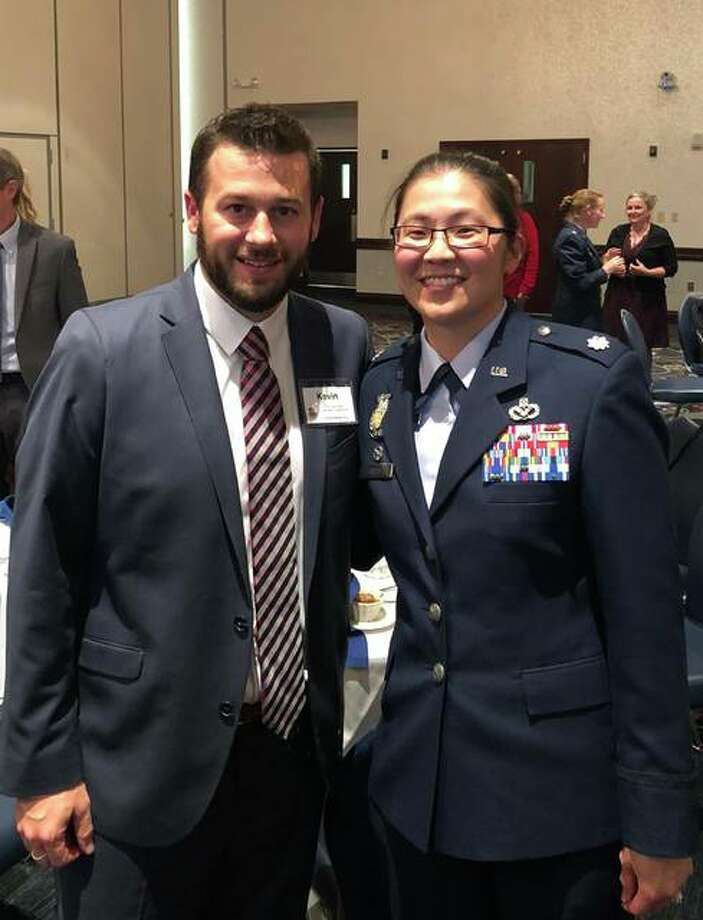 Lt. Col. Nichole Scott (right) stands with TheBank of Edwardsville's Kevin Welch. The two are to be paired up in the Honorary Commanders Program at Scott AFB. Photo: For The Intelligencer