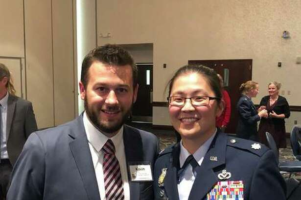 Lt. Col. Nichole Scott (right) stands with TheBank of Edwardsville's Kevin Welch. The two are to be paired up in the Honorary Commanders Program at Scott AFB.