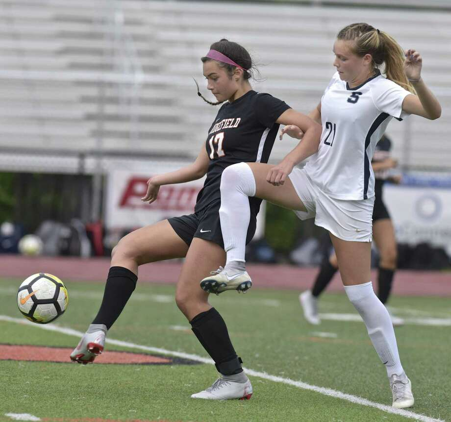 Ridgefield's Tasha Riek, left, and Staples' Reese Sutter mirror each other as they battle for the ball Oct. 9. The Class LL state championship finalists played to a scoreless draw in the regular season. Photo: H John Voorhees III / Hearst Connecticut Media / The News-Times