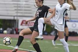 Ridgefield's Tasha Riek, left, and Staples' Reese Sutter mirror each other as they battle for the ball Oct. 9. The Class LL state championship finalists played to a scoreless draw in the regular season.