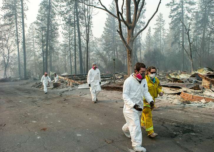 CAL Fire and a search team survey the area on Friday, Nov. 16, 2018, in Paradise, Calif. The area was devastated by the Camp Fire.