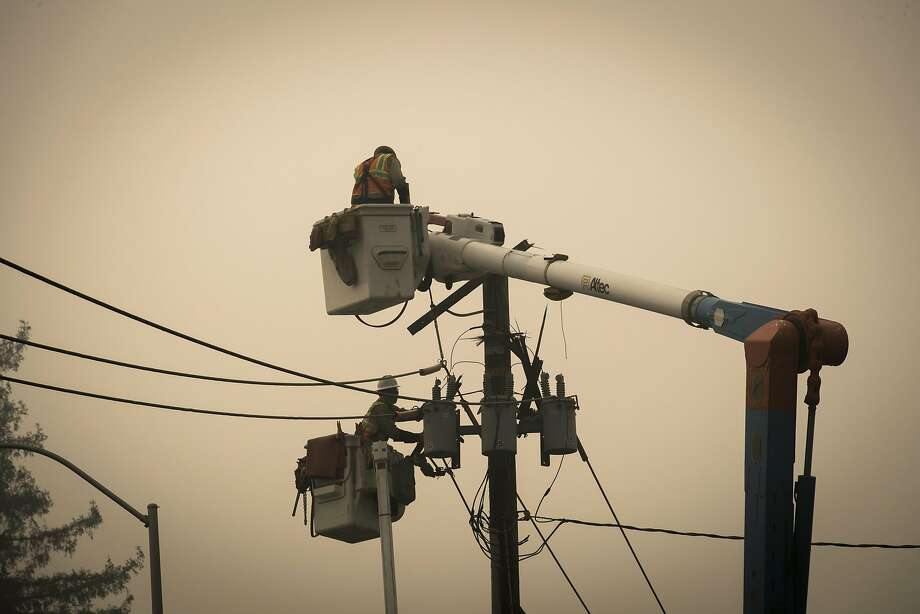 Pacific Gas & Electric Co. (PG&E) workers repair a transformer in Paradise, California, U.S., on Thursday, Nov. 15, 2018. The number of acres burned in the blazes -- including the Hill and Woolsey fires in Southern California, and the Camp fire in Northern California, which has killed at least 48 people and destroyed the city of Paradise -- already is higher than the total burned in wildfires last year, A.M. Best Co. wrote in a report late Tuesday. Photographer: David Paul Morris/Bloomberg Photo: David Paul Morris / Bloomberg