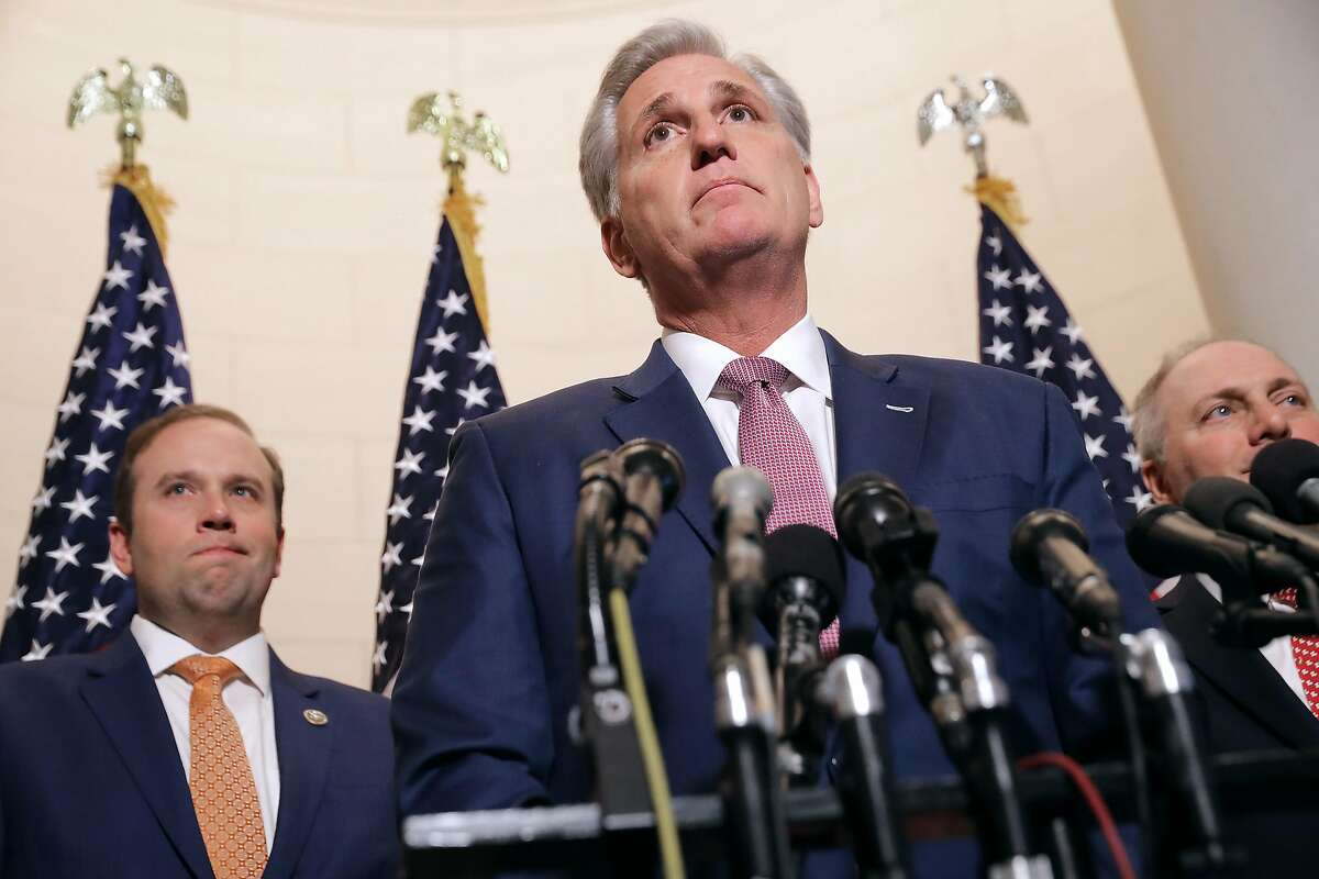 WASHINGTON, DC - NOVEMBER 14: House Majority Leader Kevin McCarthy (R-CA) talks to reporters following his election to House minority leader for the next Congress with Rep. Jason Smith (R-MO) (L) and House Majority Whip Steve Scalise (R-LA) in the Longworth House Office Building on Capitol Hill November 14, 2018 in Washington, DC. In the wake of losing more than House 33 seats to Democrats in last week's midterm elections, Republicans elected McCarthy minority leader and Scalise as minority whip for the 116th Congress. (Photo by Chip Somodevilla/Getty Images)