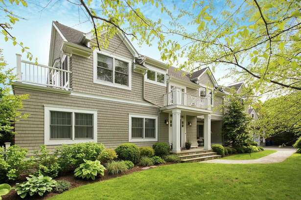 The four- to five-bedroom fully renovated home is located on a a 0.27-acre lot with an English garden. The entire exterior was recently power-washed and painted.