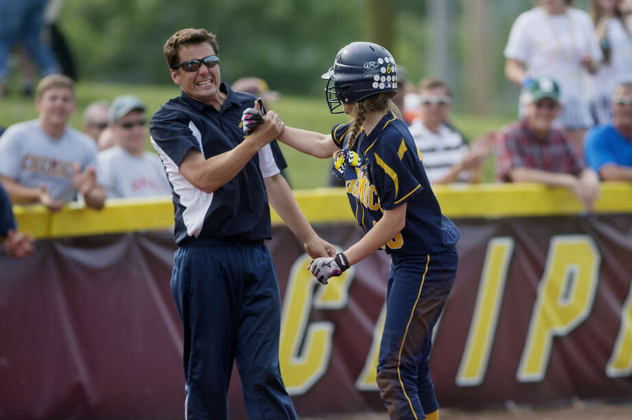 Former Midland High softball coach Robin Allen congratulates Nicole Miiller after Miiller tripled in a 2015 Division 1 quarterfinal against Caledonia at Central Michigan University. Photo: Daily News File Photo