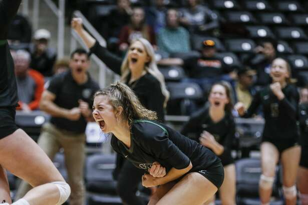 Kingwood Park seniors Yates Barker (17) and Katey Searcy (1) and their teammates celebrate beating Canyon Randall in five sets during the Class 5A State Semifinal volleyball game at the Curtis Culwell Center in Garland, Texas, Friday, November 16, 2018. Kingwood Park will advance to the State Finals. (Brandon Wade/Contributor)