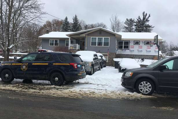 Wendy Liberatore / Times Union New York State Police investigate a fatal shooting Friday at a home at 7 Raymond St., in Corinth. The shooting was reported late Thursday. A neighbor said a couple with three children lived at there.