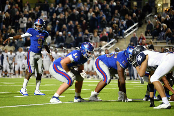 West Brook quarterback La'Ravien Elia prepares to take the snap against Kingwood in a bi-district playoff game at BISD Memorial Stadium on Friday night. Photo taken Friday 11/16/18 Ryan Pelham/The Enterprise