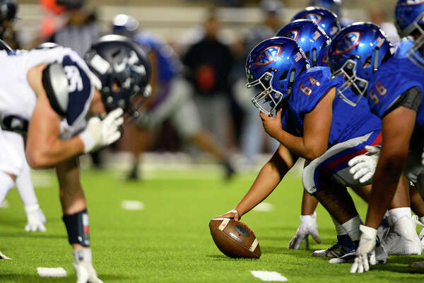 West Brook center Ja'Michael Saab prepares to snap the ball against Kingwood in a bi-district playoff game at BISD Memorial Stadium on Friday night. Photo taken Friday 11/16/18 Ryan Pelham/The Enterprise