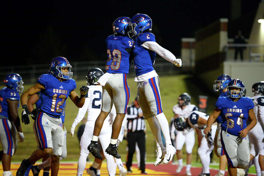 West Brook's Joey Pierre celebrates a touchdown with teammate Deonte Simpson against Kingwood in a bi-district playoff game at BISD Memorial Stadium on Friday night. 